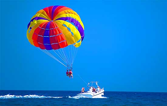 Parasailing & West Bay Beach Experience